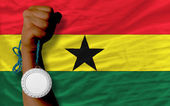 Silver medal for sport and national flag of ghana — Stock Photo