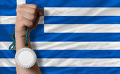 Silver medal for sport and national flag of greece — Stock Photo