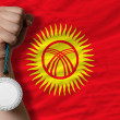Stock Photo: Silver medal for sport and national flag of kirghizstan