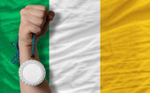 Silver medal for sport and national flag of ireland — Stock Photo