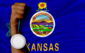 Silver medal for sport and flag of american state of kansas — Stock Photo