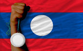 Silver medal for sport and national flag of laos — Stockfoto