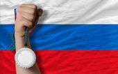 Silver medal for sport and national flag of slovenia — Stock Photo