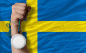 Silver medal for sport and national flag of sweden — Stock Photo