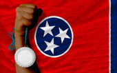 Silver medal for sport and flag of american state of tennessee — Stock Photo