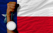 Silver medal for sport and flag of american state of texas — Stock Photo