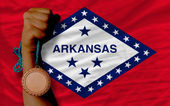 Bronze medal for sport and flag of american state of arkansas — Stock Photo