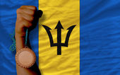 Bronze medal for sport and national flag of barbados — Stock Photo