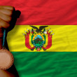 Bronze medal for sport and national flag of bolivia — Stock Photo