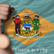 Bronze medal for sport and flag of americstate of delaware — ストック写真 #28238069
