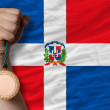 Bronze medal for sport and national flag of dominican — Stock Photo #28239219