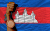 Bronze medal for sport and national flag of cambodia — Stock Photo