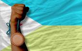Bronze medal for sport and national flag of of djibuti — Zdjęcie stockowe