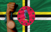 Bronze medal for sport and national flag of dominica — Zdjęcie stockowe