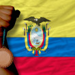 Stockfoto: Bronze medal for sport and national flag of ecuador