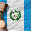 Photo: Bronze medal for sport and national flag of guatemala