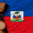Foto de Stock  : Bronze medal for sport and national flag of haiti