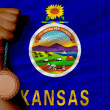 Photo: Bronze medal for sport and flag of americstate of kansas