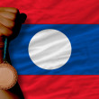 Bronze medal for sport and national flag of laos — Stockfoto #28248033