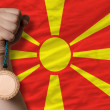 Bronze medal for sport and national flag of macedonia — Stock Photo #28248239