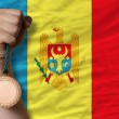 Stockfoto: Bronze medal for sport and national flag of moldova