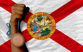 Bronze medal for sport and flag of american state of florida — Stock Photo
