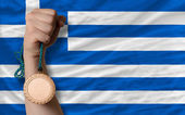 Bronze medal for sport and national flag of greece — Stock Photo