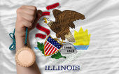 Bronze medal for sport and flag of american state of illinois — Stock Photo