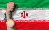 Bronze medal for sport and national flag of iran — Stock Photo