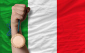 Bronze medal for sport and national flag of italy — Stock Photo