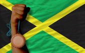 Bronze medal for sport and national flag of jamaica — Stock Photo