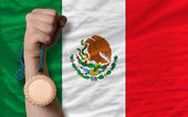 Bronze medal for sport and national flag of mexico — Stock Photo