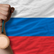 Bronze medal for sport and national flag of russia — Stockfoto #28252243