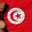 Bronze medal for sport and national flag of tunisia — Stock Photo #28254325