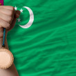 Stockfoto: Bronze medal for sport and national flag of turkmenistan
