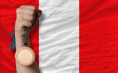Bronze medal for sport and national flag of peru — Stock Photo