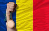 Bronze medal for sport and national flag of romania — Stock Photo