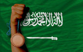 Bronze medal for sport and national flag of of saudi arabia — Stock Photo