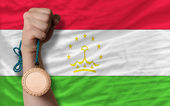 Bronze medal for sport and national flag of tajikistan — Stock Photo