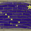 Grunge flag of US state of alaska on brick wall painted with cha — Stock Photo #8737093