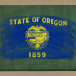 Flag of us state of oregon on blackboard painted with chalk — Stock Photo #8840384