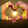 Heart and love gesture by hands colored in sri lanka flag during — Stock Photo #9902473