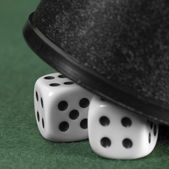 Gambling tension with hidden dice — Stock Photo