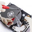 Technician with open hard-disk — Stock Photo #14172273