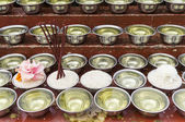 Small bowls with water and rice around a temple — Stock Photo