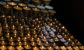 Many candles in a row — Foto Stock