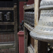 Bell and prayer wheels in nepal — Stock Photo