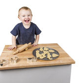 Child making cookies — Stock Photo