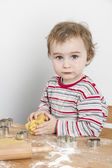 Young child making cookies — Stock Photo