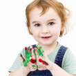 Cute girl with finger paint — Stock Photo